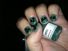 She Works Hard For The Money by BadAssNailLacquer and #black confetti applied with Seche Vite top coat. #nailpolish #green #holo #glitter