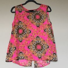 "Pink open back Jack by BB Dakota top Jack top in vibrant pink, gold, and black patterns. Back overlaps and opens up (see second and third pics). Size S. Excellent condition - only very minor wear. Measurements (taken in front and lying flat - back opens up and is a little longer): bust 18.5-19"" across, waist 19.5"", hips 23"", length from shoulder 23"" Jack by BB Dakota Tops"