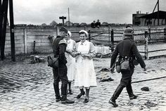 DRK nurses talk with a Wehrmacht soldier, while another walks by - World War II Ww2 Photos, History Photos, Women In History, World History, Women's Army Corps, Germany Ww2, Military History, World War Two, Wwii