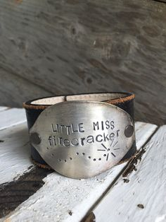 little miss firecracker! This leather cuff is crafted from upcycled leather and…