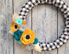 ON SALE - 15% Discount and Ready to Ship  Heres a non traditional fall wreath to brighten your door this season. Black and white plaid ribbon is wrapped around a 14 styrofoam wreath then decorated with an assortment of handmade felt flowers. The main flowers are mustard yellow poppies and also includes flowers in peacock blue, aqua, gray and felt balls. There is a twine loop on the back for easy hanging. Your wreath is made upon ordering. Please allow 3-5 days for shipping. To prolong life…