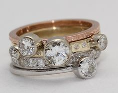 Elaina Designs:  Stacking diamond rings in three colors of gold.    I so want to do something similar to this to remake my bridal and a couple of anniversary rings!
