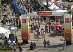 The crowd wanders through the food vendor area ouside Plaza Tropical during the final day of Musikfest on Sunday.