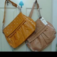 *REDUCED* Multi-Style Handbags Super Cute* Snap buttons on handle allow you to convert it from a Shoulder bag to a Wristlet. Remove the handle to convert into a Clutch.  You can flip the top backwards for a different look as well.  ** 2 Colors to choose from **   Colors: Tan & Mustard Mad Style Bags