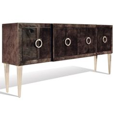 Buffet is manteled with died goatskin with a polished high-gloss topcoat, brass ring hardware and brass cladded legs.  Finish on picture: Goatskin (brown) - Polished Lacquer/High Gloss  Size: W 72 x D 14 x H 33 inches