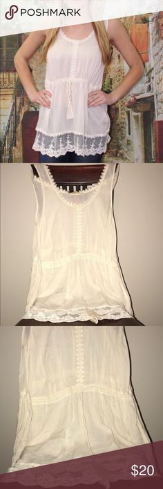 """Adorable ENTRO Baby Doll Boho Top!🌸🌸 Has the the timeless look of many of ENTRO fashion. Sweet and flirty with lace and crochet details with a beautiful tie with tassels on the front. Can be easily dressed up or down!  Bought new at a boutique and I never wore it because I was afraid I would stain it.  Bust line appx 16.5"""" 100% Rayon.  Not too much stretch due to lace and crochet work. As always, reasonable offers are considered!😍💕 First pic is true color! ENTRO Tops Camisoles"""