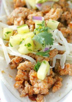 These ground pork tacos are made Al Pastor style with fresh pineapple salsa and pork cooked in orange juice and spicy chipotle sauce.