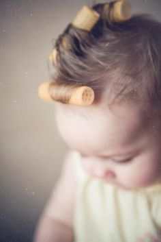 aww, cute....reminds me of how I used to put curls in my oldest daughter's hair back when.