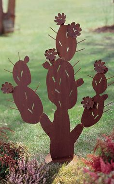 Giant Metal Cactus Sculpture.  You can hang wine bottles on the spikes.