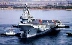 China's first aircraft carrier (refurbished Russian Varyag) Liaoning returning to port in Quingdao after training cruise. Cruisers, Stealth Technology, Model Warships, People's Liberation Army, Man Of War, Navy Aircraft, Army & Navy, Navy Ships, Aircraft Carrier