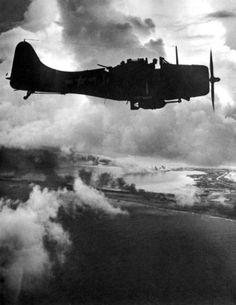 Dawn attack by Douglas dauntless dive bombers, Wake Island burns below, 1943 © Charles Kerlee