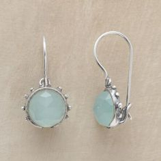 This pair of silver beaded chalcedony earrings exudes a cool sense of serenity.