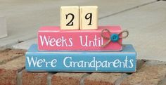 DIY this with wooden calendar blocks- count up and write Weeks Old/Months Old on the reverse sides