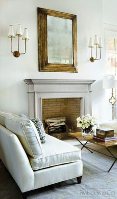 Simple and elegant English fireplace with a breakfront shelf and inner moldings running along the hearth opening.