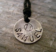 Boys Sports Necklace ... wonder if my boys would wear it.  Would make a cool end of season memento ... stamp the year on the back.   $25