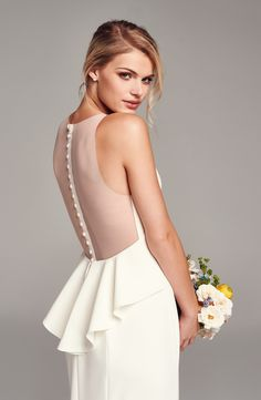 So in love with the sheer back and the beautifully ruffled and ultrafeminine peplum waist of this sophisticated crepe wedding gown.