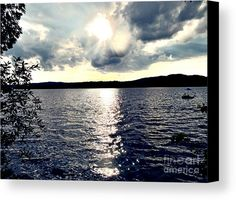 Luminous Lakeside Canvas Print by Onedayoneimage Photography.  lake, sunset, illuminated, sunshine, sunlight, landscape, lakeside, clouds, sky, sun rays, rays, horizon, mountain, sparkling, rippling, water, boat, cloudscape, shiny, shining, dusk, summer, summertime, relaxing, peaceful, vacation, maine, new england, home decor, office decor, wall art, canvas, prints