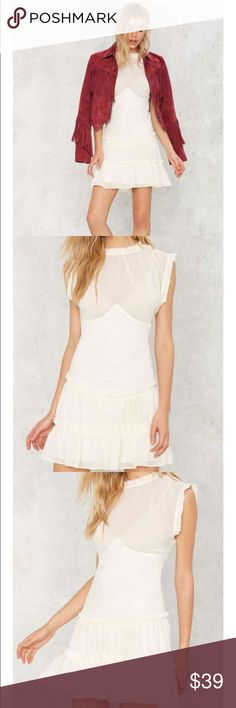 Nasty Gal NWT sheer ivory lace party dress 👗 M We just got seduced. The Crew Intentions Dress comes in sheer white and features a crew neckline, pleating at collar, ruffled detailing at skirt, and sleeveless mini dress design. Slip lining from waist down. By Nasty Gal.  *Polyester  *Runs true to size  *Hand wash cold  *Imported Nasty Gal Dresses Mini
