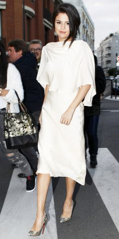 Selena Gomez in a caped ivory silk Sybilla backless dress with Louboutin pumps. Selena Gomez in a caped ivory silk Sybilla backless dress with Louboutin pumps. Estilo Selena Gomez, Selena Gomez Style, Selena Gomez White Dress, Selena Selena, Street Style, Style Snaps, Red Carpet Looks, Her Style, Celebrity Style