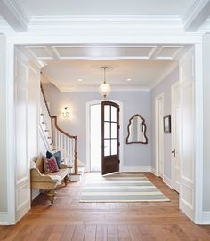 This crisp foyer is painted in Gray Screen by Sherwin Williams and the millwork is painted in Icicle by Benjamin Moore.