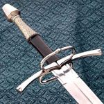 15th Century Medieval Longswords for sale are a mighty 45 ½ inches in all. These functional hand-and-a-half swords have a steel guard and pommel and are designed like medieval 15th Century long swords. They are considered a medium weight sword, weighing 3 pounds 4 ounces and can be used as either single-handed or two-handed. The real leather covered wooden handle features a wire wrap.