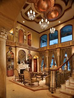 Lichi-Zelman Style Living Room - Beautiful blend of marble, iron, and wood on the staircase.