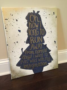 Alice in Wonderland silhouette with quote. Navy blue and gold on canvas.
