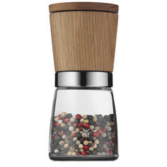 The Ceramill Nature Salt and Pepper Grinder is particularly elegant with the combination of glass and wood. The Mill is unique with the grinding mechanism on top. To use the mill, remove the lid, turn it upside down, and grind. Since the grinding mechanism is on top there are no spice crumbs left on your kitchen table.