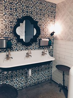 Kohler triple trough sink with spectacular tile backdrop.  Don't want a single small mirror.