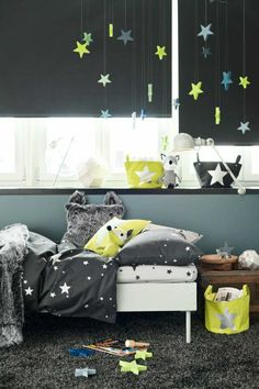 Hanging stars like jewels soften the whole look | 10 Dramatically Dark Kids Rooms - Tinyme Blog