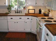 butcher block counter tops with white cabinets