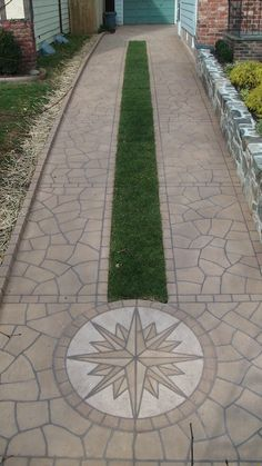 Hand crafted stone driveway with grass inlay