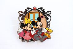 This pretty Disney pin features Mickey and Minnie Mouse holding hands and all dressed up! It's from Hong Kong Disneyland 2009 and is retired. GUARANTEED AUTHENTIC & SCRAPPER-FREE