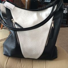 Ex Large Handbag By Kensie Traded Black and white with plenty of storage has two outside zipper compartments one inside zipper compartment. Plus phone storage. If you like large bags this is the one for you.Has long adjustable strap as well as short one Kensie Bags Shoulder Bags