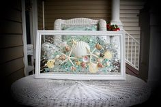 This Sea Glass Art is a beautiful piece that is ready to great to hang on a wall or a window! Any beach lover would treasure this piece forever.  The shells are bonded onto the glass with resin. The simple classic frame measures approximately 22 x 12, and is pure white in color.  Among the Blue Wall Decor, Pink Wall Art, Coastal Bathrooms, Bathroom Wall Art, Sea Glass Art, Window Art, Victorian Art, Coastal Decor, Sea Shells