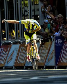 TOUR DE FRANCE - STAGE 16 PHOTO GALLERY - Australia's Michael Rogers of Tinkoff-Saxo celebrates with a bow before crossing the finish...