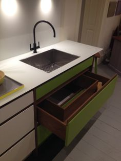 All space is utilised in the Pure #kitchen, even under the sink! This design is great for storing cleaning equipment.
