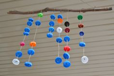 How We Montessori: Wind chime with bottle tops.  we don't have lots of bottle tops around our house so it would take a lot of collecting to create this.  So...worth it though. How fuN!!