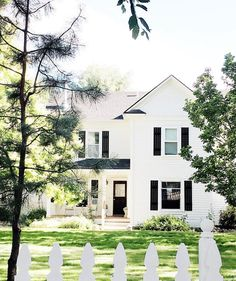 The most charming white house and picket fence. // http://www.studio-mcgee.com