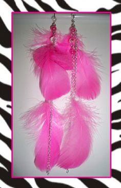 Radiant indeed, these electric fuchsia feather earrings are decorated with three multi-length feathers attached to sterling-plate cable chain. In addition to the vibrant feathers, these beautiful earrings also dangle a fuchsia crystal decorated matching chain...for that extra ka-pow-kick!