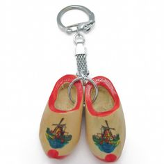 """Charming and colorful key chain featuring a pair of Dutch wooden shoes on a keychain. - Approximate Dimensions (Length x Width x Height): 3.75x1.75x0.75"""" - Material Type: Wood"""