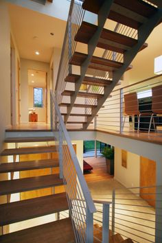 Custom Painted Steel Staircase | Spiral Stairs | Floating Steps | Woodworking | Metalworking | Modern | Interior | #BlankandCables With a stunning view and a roof deck to die for, it's no wonder we were hired to create a modern three story staircase, for rooftop access, in lieu of a traditional stairway. The finished look used painted mild steel, open backed steps and steel handrails that exude modernity as residents climb their way up to this rooftop lookout. Photography: Paul Dyer