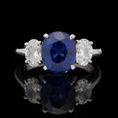 Madagascar Blue Sapphire and Diamond Ring   From a unique collection of vintage three-stone rings at https://www.1stdibs.com/jewelry/rings/three-stone-rings/