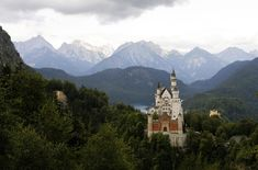 Neuschwanstein Castle, perched on a rugged hill in front of the Alpine foothills near Füssen, in southwest Bavaria, Germany, viewed on July 31, 2007. Neuschwanstein was commissioned by Bavaria's King Ludwig II and designed by Christian Jank, a stage designer from Munich. Construction began in 1869, but it was only partially completed, with 185 interior rooms of a planned 200 left unfinished.