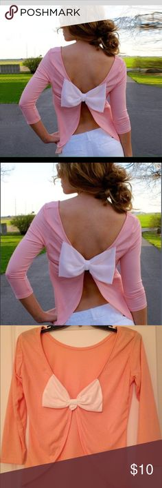 HP Swing Back Bow Blouse  Host Pick: 6/22- Back To Basics PartyLightweight baby pink blouse with open back that features a white bow.  Sleeves are three-quarter length.  Cotton/polyester blend. NWOT Boutique  Tops Blouses