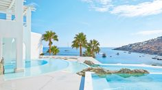 Mykonos Blu - NEW infinity pool hovering over Psarou's beach    #LuxuryResorts  #5StarHotels