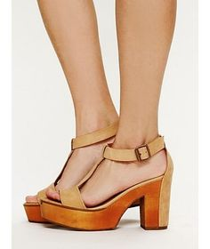 Leather strappy platform sandal with chunky heel. Full wood