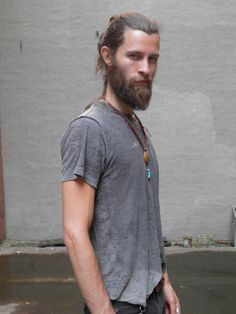 hippie man with long hair and beard + necklace
