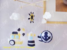 Baby Mobile - Baby Crib Mobile - Nursery Decor - Hanging Nautical Mobile - Ocean Mariner Blue White Yellow theme (Custom colors available). $88.00, via Etsy.
