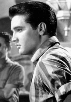 elvis photo |  Terry: This picture is really something as it shows Elvis as he really was. He was so masculine, his clothes always fit his personality, everything is smooth going and he attracts your attention.